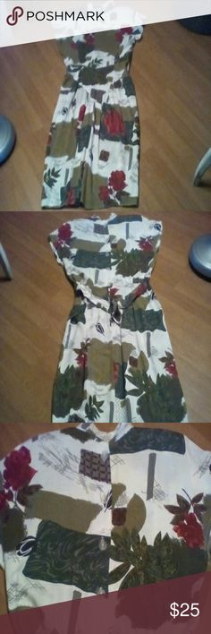 Dress Gorgeous,  midi length dress.  Roses and graphics, reds, greens, gold.  Dropped waist in the front, back has a beautiful look with buttons, zipper and a one button tie.  Rayon, acetate.  Like new condition.  Thanks for stopping by! Betsey's Things Dresses Midi