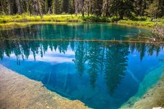 This hidden gem known as Little Crater Lake is one of the most beautiful places you can explore in the Mount Hood area of Oregon.