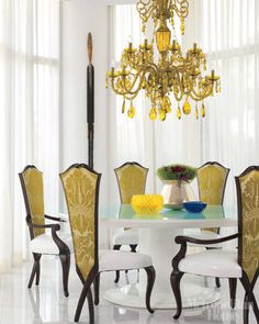 Sheer white drapes and a white clean-lined table make for a lovely juxtaposition.