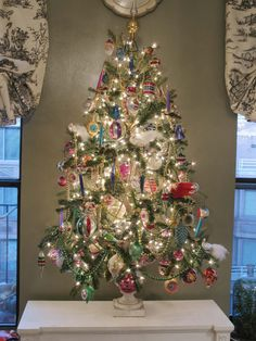Use a tabletop tree to showcase a collection that might get lost on the big tree.