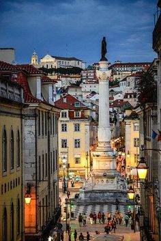 Travel Inspiration for Portugal - Column of Pedro IV in Rossio Square viewed at Night from Bairro Alto - Lisbon Portugal