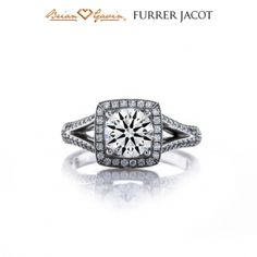 Give her the royal treatment she deserves with this queenly Split Shoulder halo ring. This 3/4 Eternity ring features one shank that at first glance appears to be two radiant bands joined together. The thin, melee adorned strips diverge as they approach the top of the ring forming a lustrous triangular open shoulder, making the piece lightweight yet sound. An impressive square halo appealingly encircles a round white center diamond.