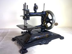 "ANTIQUE MULLER ""MODEL 12"" TOY SEWING MACHINE"