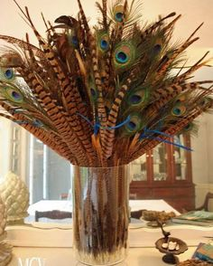 Ringneck Pheasant Feathers and Peacock Eye Feathers combine in this lovely centerpiece.  Get these natural beauties from our store today! (FYI- All of our feathers are humanely collected after they are naturally shed, no birds are harmed to retrieve these feathers.  They are also all cleaned before being sent to you, so they are ready to use!)  #homedecor #decoration #livingroominspiration #livingroominso #diyhomedecor #decorating #decorideas #homestyle #deco