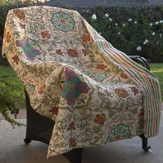 "Perfectly folded at the foot of your bed or draped across the living room chaise, this cotton throw showcases a medallion motif and an eye-catching palette.   Product: ThrowConstruction Material: CottonColor: Multi  Features: Reversible    Dimensions: 50"" x 60""  Cleaning and Care: Machine washable, tumble dry"