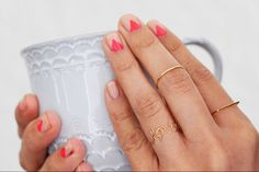 Use office tape to create a stencil for nail art.