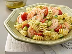I have made this now three times this summer.  It is so refreshing.  Add more shrimp, decrease the pasta.  The lemon/dill  vinaigrette recipe is to die for.  Use it for other salads.. Cold and refreshing.. Wish I had fresh tomatoes to do it with!!