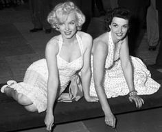 Marilyn Monroe and Jane Russell putting signatures in cement at Chinese Theater in Los Angeles, Calif., 1953