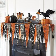 Slip the Bewitching Mantel Scarf over the shelf of your mantel, then top it with your favorite Halloween decorations and create an unforgettable display. Layered, pennant-shaped composition is made fr (Halloween Table Arrangements) Spooky Halloween, Halloween Home Decor, Halloween Projects, Holidays Halloween, Halloween Themes, Halloween Fireplace, Halloween Table, Halloween Bunting, Cheap Halloween Decorations