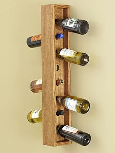 Wall-hung Wine Rack. This easy-to-build wall-mounted wine rack turns wine storage into a work of art. Weekend Project- See more at: http://www.woodstore.net/plans/gifts/kitchen-accessories/400-Wall-hung-Wine-Rack.html#sthash.lV8n6BAg.dpuf