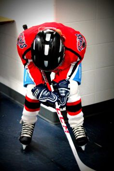 My son getting ready to be the 7th player at the 2012-13 home opener of the Lethbridge Hurricanes.