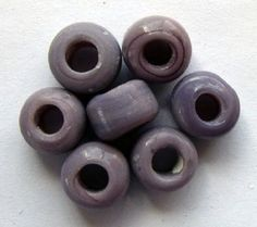 Crow Beads Lilac Opaque size 9mm x 6mm with a 3mm hole
