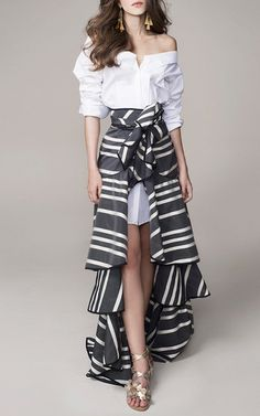 This striped **Johanna Ortiz** skirt is rendered in silk organza and features a wrap style with a tiered ruffle construction.
