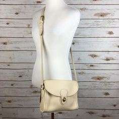 "[Vintage] Coach Devon Saddle Crossbody Bag 9908 Authentic vintage Coach Devon Crossbody bag style 9908. Rare light beige/cream color leather. Flap front with toggle closure. Leather logo hang tag. Adjustable long strap. Open interior with one smaller zip pocket.   Dimensions: 9"" W x 6.5"" H x 2.5"" D Strap Drop: 20"" - 23"" Condition: GUC. Overall in Excellent shape. Small pen mark on front left of bag and small red mark near toggle. A few small marks on interior lining. Shown in last photos…"