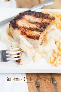 Buttermilk grilled pork chops, pretty much the juiciest pork chop ever. Ohsweetbasil.com