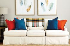 For maximum drama, we like to mix two pairs of solid pillows in the very brightest of hues, like peacock and spice. These two strong colors are opposites on the color wheel which means that make the most splash when paired together.