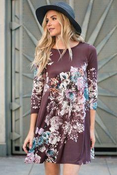 Floral poly spandex shift dress. Hidden pocket. 3/4 sleeve.