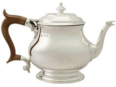 Vintage Silver Teapot in the George I Style http://www.acsilver.co.uk/shop/pc/Sterling-Silver-Teapot-George-I-Style-Vintage-Elizabeth-II-49p9005.htm