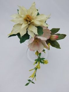 White poinsettias, hellebores and winter jasmine would make the perfect sugar flower spray for a winter wedding cake.