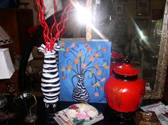 ART AND VASES -ART OF ANY KIND the zebra vase is $75.00 the painting is $75.00 and the red ginger jar is $100.00  all are hand painted in our shop all3  $225.00