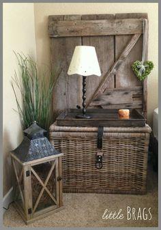Little Brags.  Metal tray on basket, metal lantern, rustic wood.