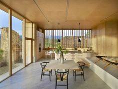 Kitchen. Birch plywood cabinets and table. Larch louvers. Designer: Carl Fredrik Svenstedt.