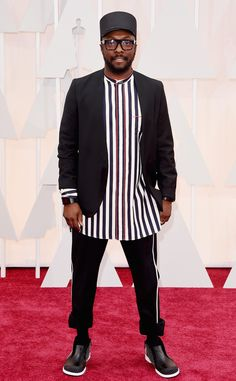 will.i.am from 2015 Oscars: Red Carpet Arrivals. Good grief. He looks like a cross between a prisoner and a train conductor. Ridiculous.