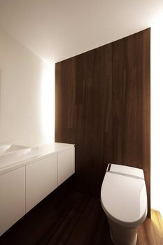 :: BATHROOMS :: Photo Credit: Satoru Hirota Architects. Note: Wood panel feature with hidden cove lighting to provide a more diffused source of light, a much greater option for illuminating a bathroom versus overhead shadows cast with regular pot lights #bathrooms