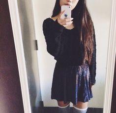 Black fuzzy sweater with navy blue velvet skirt and gray ruffle knee-high socks