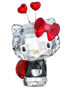 """See Hello Kitty spread her wings in this Swarovksi crystal figurine, featuring ladybug spots and heart-topped antennae. 