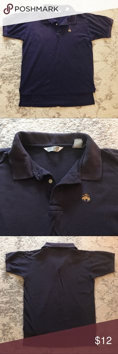 Navy blue Brooks Brothers Golden Fleece polo shirt Navy blue Brooks Brothers short-sleeved polo shirt from the Golden Fleece collection. This shirt is technically sized XL, but, because it's older and sizes have changed a bit since then, it fits more like today's Medium. This shirt is worn, but there is still a lot of life left in it. Brooks Brothers Shirts Polos