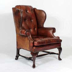 Pair of Early 20th Century Brass Tacked Tufted Leather High Back Wing Chairs   From a unique collection of antique and modern wingback chairs at https://www.1stdibs.com/furniture/seating/wingback-chairs/