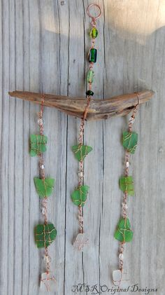 Sea glass wind chime, made using genuine sea glass, copper wire and drift wood. Created by MSRoriginaldesigns