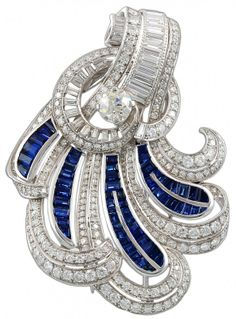 Circa 1940's Platinum Diamond & Sapphire Scroll Brooch. Approx. center stone 1.98cts. Year Made: 1940's