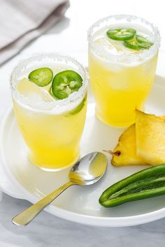 Spice up your happy hour with this pineapple paloma! Fresh pineapple makes for a perfectly sweet refresher while jalapeno slices spice up this elegant drink. eatwell101.com