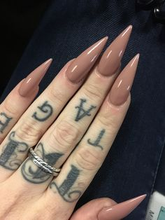 Dusty pink stiletto nails.