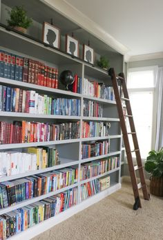 Love this wall of bookshelves and that library ladder!