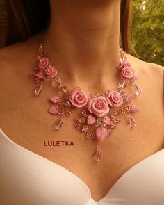 Pink rose and pink leaf design with wire and baby pink beads. Pretty necklace…