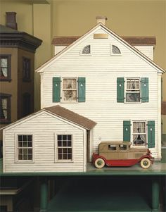 Vintage Dollhouse! o my goodness I love this doll house wow I would of went crazy if this  house would of been in my bedroom when I was little sooooooooo cute and the car LOVE