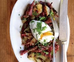 Corned Beef Hash Recipe | Epicurious.com — Ingredients for Corned beef: 2 pounds uncooked corned beef brisket (about 1 small)  included: parsley; 3 bay leaves; 1 tBsp black peppercorns; 1 tBsp coriander seeds; 1 tBsp yellow mustard seeds; 1 onion;  1 large russet potato. Hash: 1/4 cup flat-leaf parsley; Kosher salt, freshly ground pepper; 4 tBsp unsalted butter; 1 tsp distilled white vinegar; 4 large eggs;  Chopped fresh chives