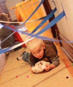 Challenge the kids to a spy game scavenger hunt. Who can get to the end without having to start over when they knock down the tape?
