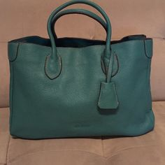 Jill Scott all leather tote Beautiful and unique Tiffany blue color tote, medium size, all leather, top snap closure, middle pocket with zipper insider plus three more small pockets, very roomy and all lined. Brand new, never used. Jill Scott Bags Totes