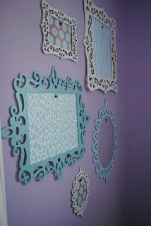 Naptime Decorator: Wall of Masterpieces - Laser Cut Frames from Michaels, Scrapbook Paper taped to the back, Hotglue Binder Clips