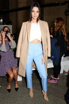 Kendall Jenner's Front-Row Look Is PERFECT For Spring  #refinery29  http://www.refinery29.com/2015/02/82716/kendall-jenner-blue-pants-outfit#slide-1  Kendall Jenner attended the Topshop Unique show during London Fashion Week in a camel duster, wavy-hem crop top, and the brilliant pair of blue, pleated trousers we all need in our lives.