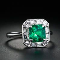 I probably could never find a ring i love more than this!!!! 1.75 carat Emerald and Diamond Ring.
