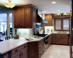 Medallion Cabinets Oak Cabinets, Farmhouse Cabinets, Kitchen Cabinets, Medallion Cabinets, Mushroom Decor, White Countertops, Wooden Planters, Garden Table, Planting Flowers