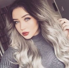 Beautiful silver/grey hair with dark roots.
