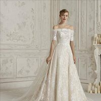 Image may contain: 1 person, wedding Designer Wedding Dresses, Wedding Gowns, Wedding Day, That Look, Bride, Showroom, Unique, Lace, Weddings