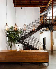 Nice pendants.  Wood reception desk really warms up the space