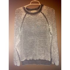 Grey sweatshirt A warm grey sweatshirt bought in Spain. It's pretty casual left alone but can be dressed up with a statement necklace. It's very comfortable and chic for a sporty look. Zara Sweaters Crew & Scoop Necks